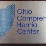 Brushed Aluminum with cut logo and lettering
