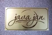 Brushed aluminum logo signage